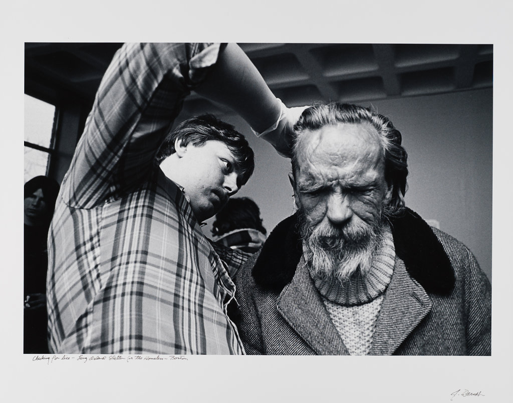 Checking for lice, Long Island Shelter, Boston, 1983