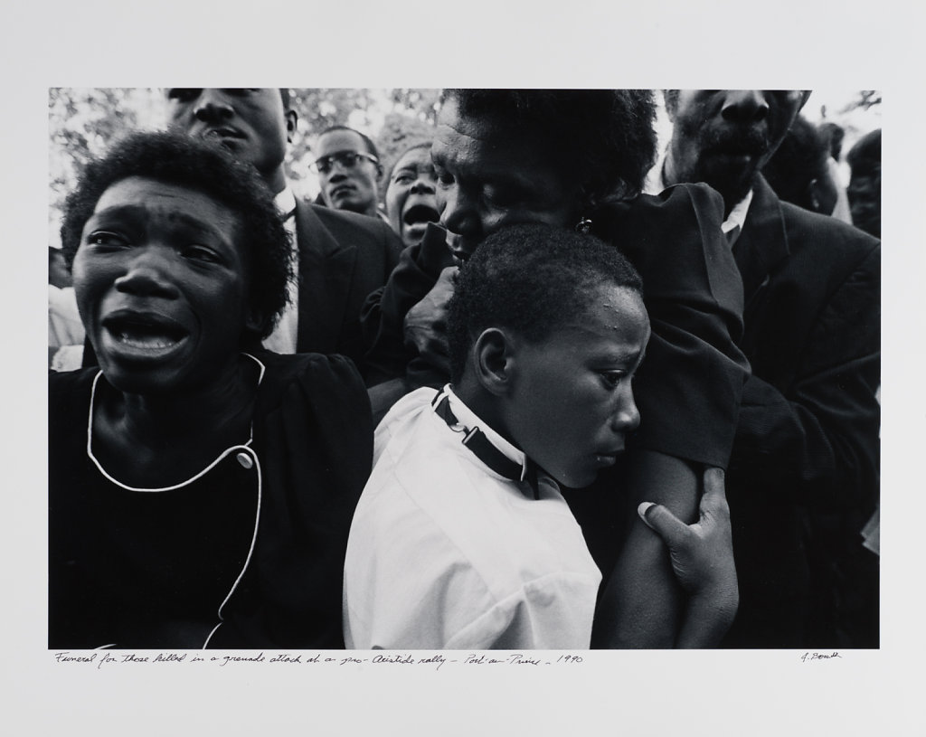Funeral for those killed in a grenade attack at a pro-Aristide rally, Port-au-Prince, Haiti, 1989